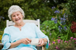 woman enjoying tea on patio