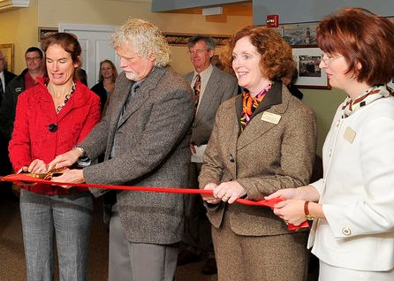 Ceo of woodlands assisted living cut the ribbon after introducing