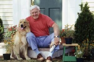 man and golden retriever on doorstep