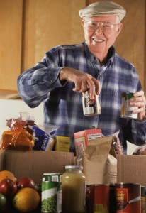Stamp Out Hunger, man putting away groceries