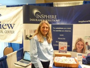 Karen Vachon of Insphere Insurance staffs her booth at the Southern Maine Senior Expo